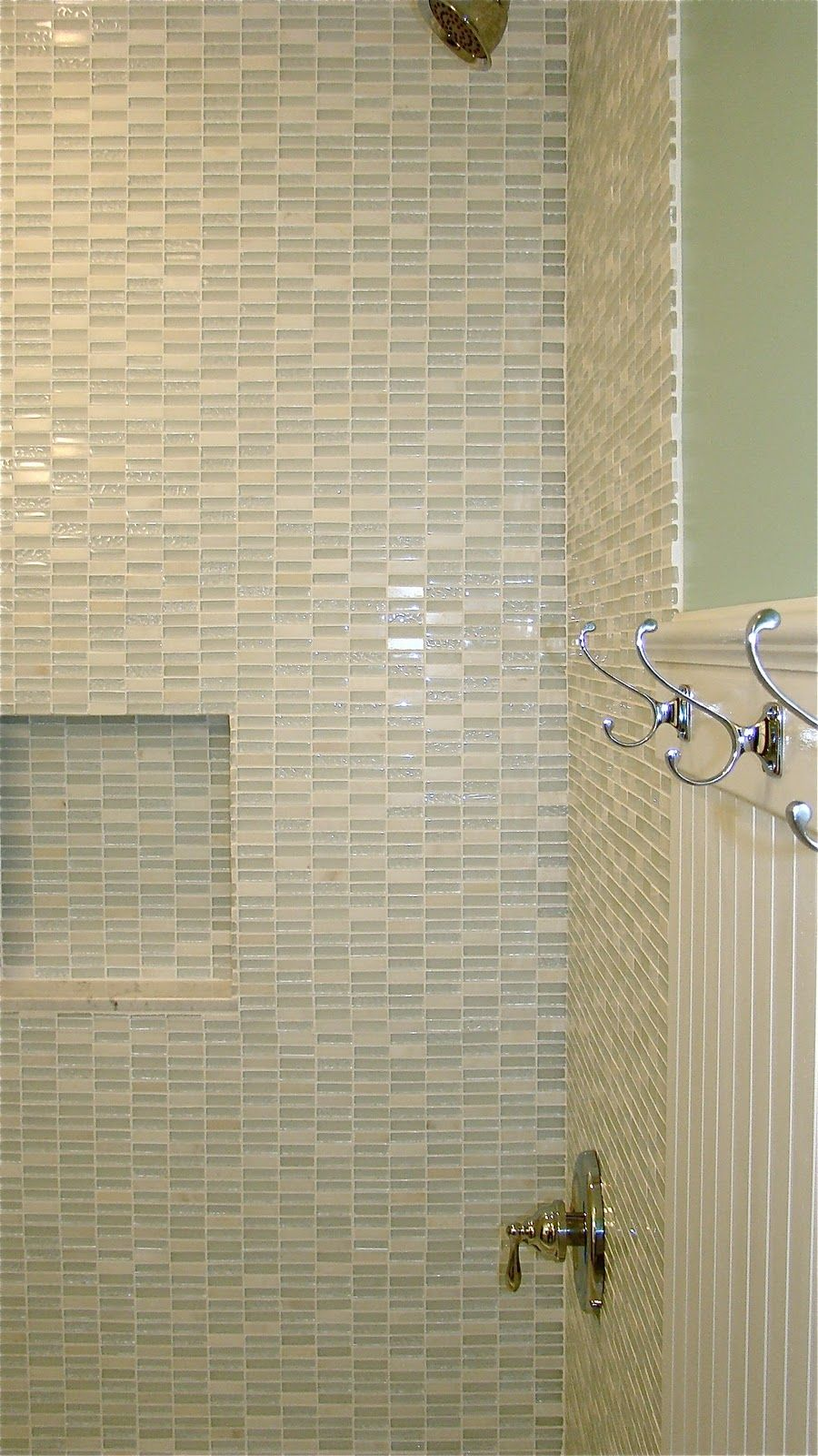 Here are the photos from the girls bathroom remodel. We wanted to mix some  of the newer trends, like glass tile and Q uartz with some of .