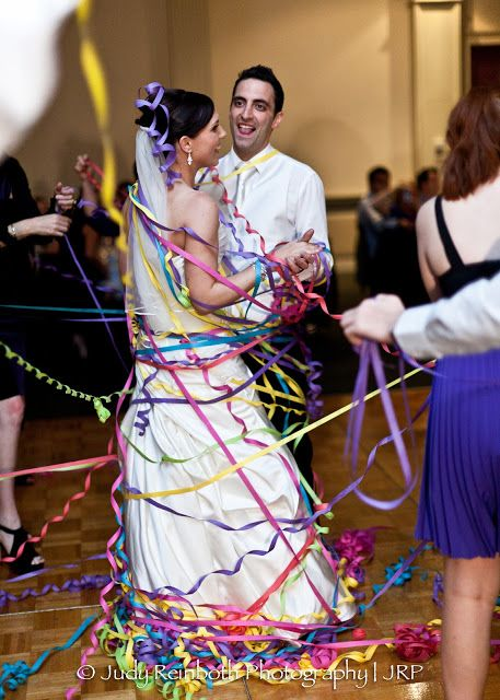 Italian American Tradition Girls Wrap The Bride And Groom In Streamers During Their First D Italian Wedding Traditions Wedding First Dance Wedding Streamers