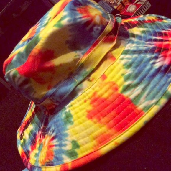 Tie-dyed drawstring bucket hat BRAND NEW ! Tie-dyed bucket hat with  adjustable string. Never worn! Also has buttons on the sides to pin the  sides up. 2329a627bd6e