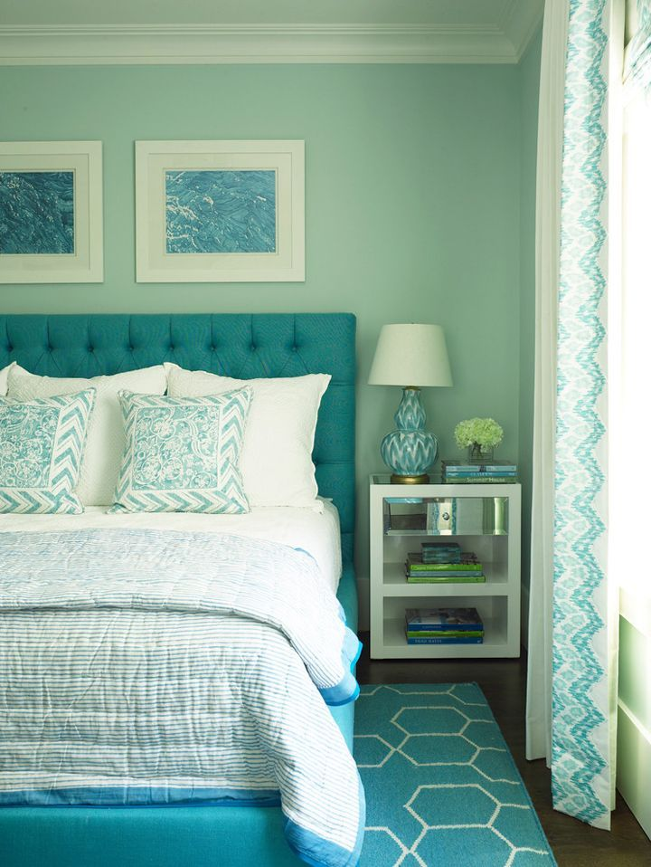 turquoise bedroom. Blue framed art hangs on an aqua wall above a turquoise blue tufted bed  placed trellis rug and dressed in white stripped 22 Amazing Turquoise Room Decorations Decoration