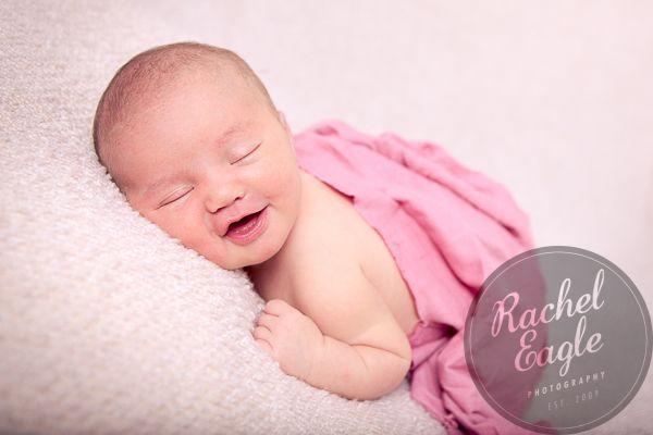 Smiley newborn in pink rachel eagle photography rochester mn www racheleagle com
