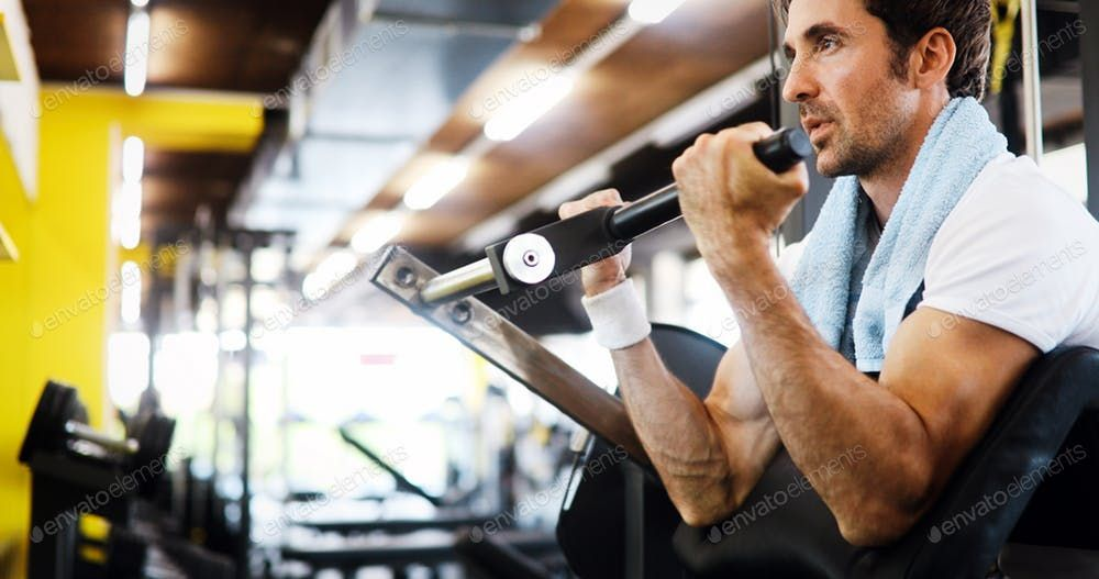 Sport, fitness, bodybuilding, lifestyle and people concept - man exercising in gym By nd3000¡¯s phot...