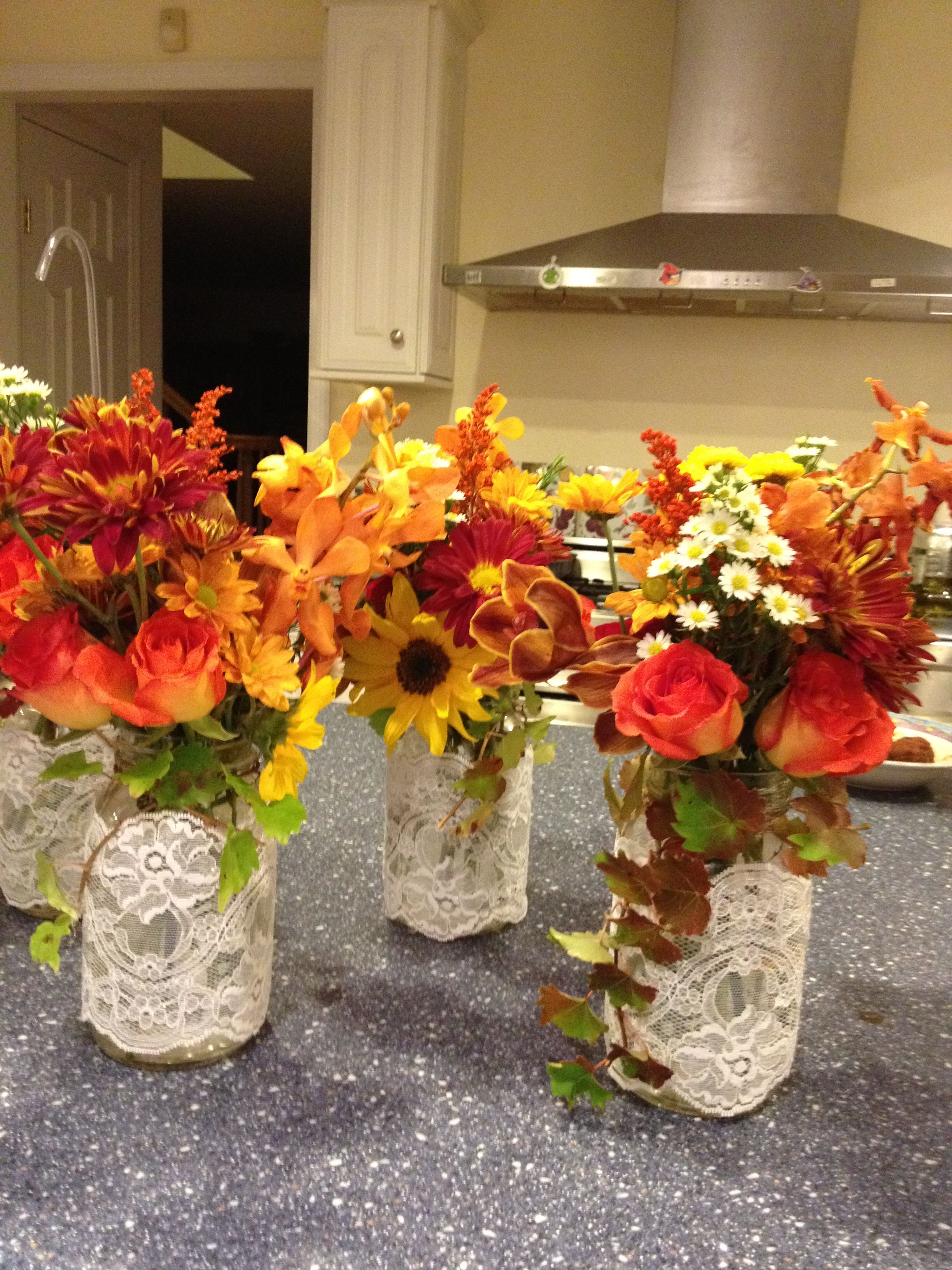 Mason jar centerpiece with fall colors and lace giving in