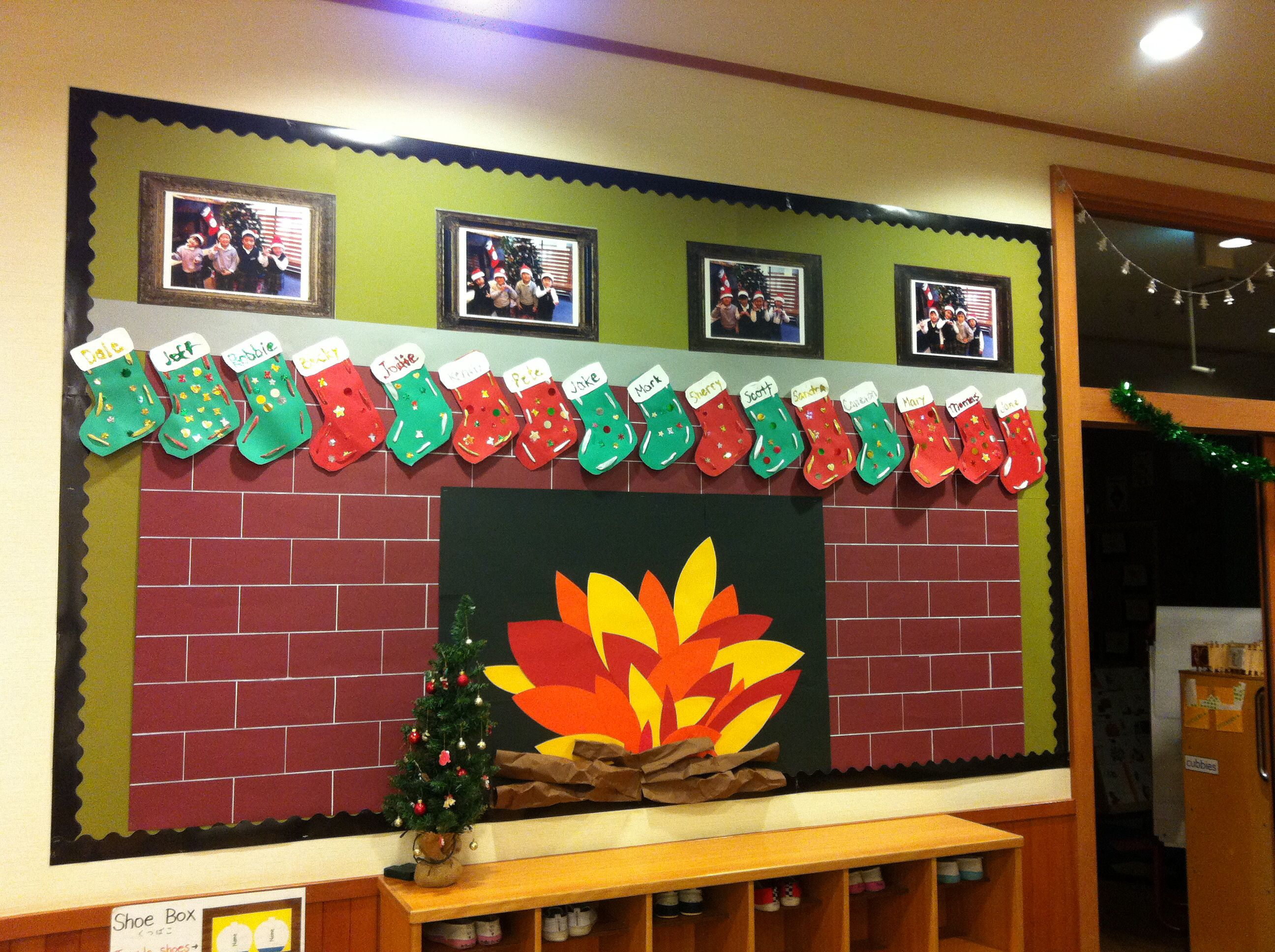 Christmas Bulletin Board Fireplace With Child Made Stockings And Class Pictures