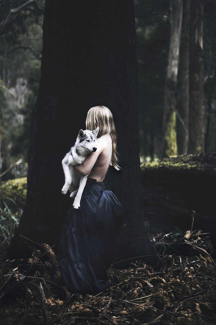 Haunting Fantasy of a Woman Running with Wolves in a Forest