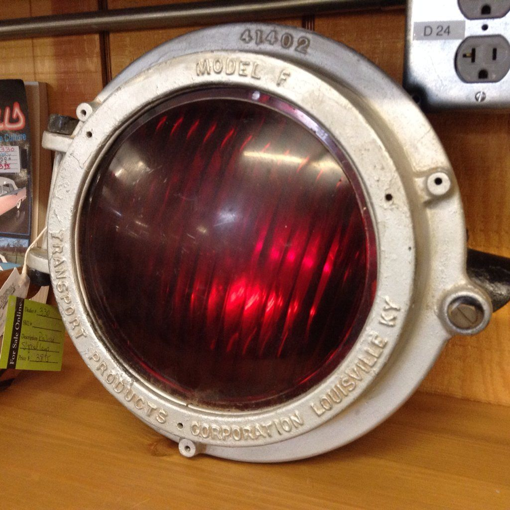 This railroad signal lamp is Model F from Transport Products of Louisville, Kentucky. It is a little over a foot in diameter. $38.95 USD Loft Booth X-35