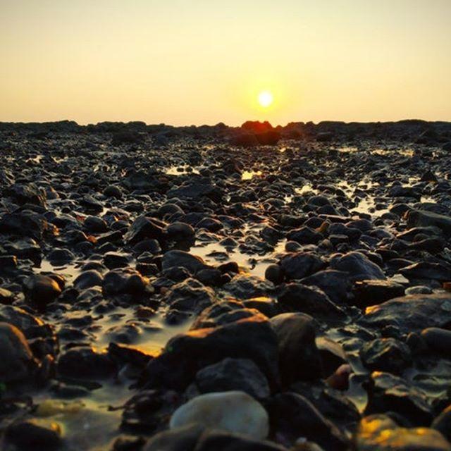 Sunset on a beach in AlibagMaharashtraIndia    Sunset on a beach in AlibagMaharashtraIndia