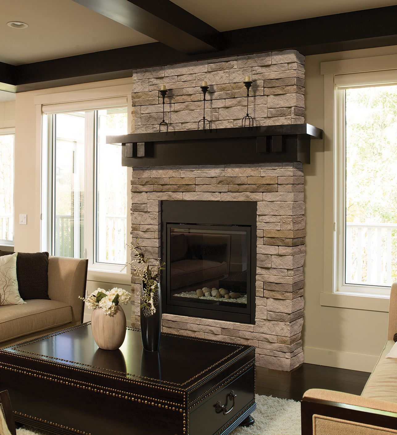 mortarless stone veneer is a great way to update a fireplace http