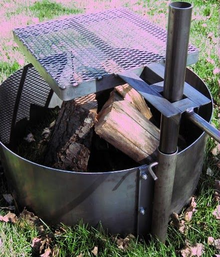 Fire Pit Ring With Adjustable Cooking Surface This Is What I M Getting My Husband For Fathers Day Discovered It On Fire Pit Cooking Fire Pit Fire Pit Grill