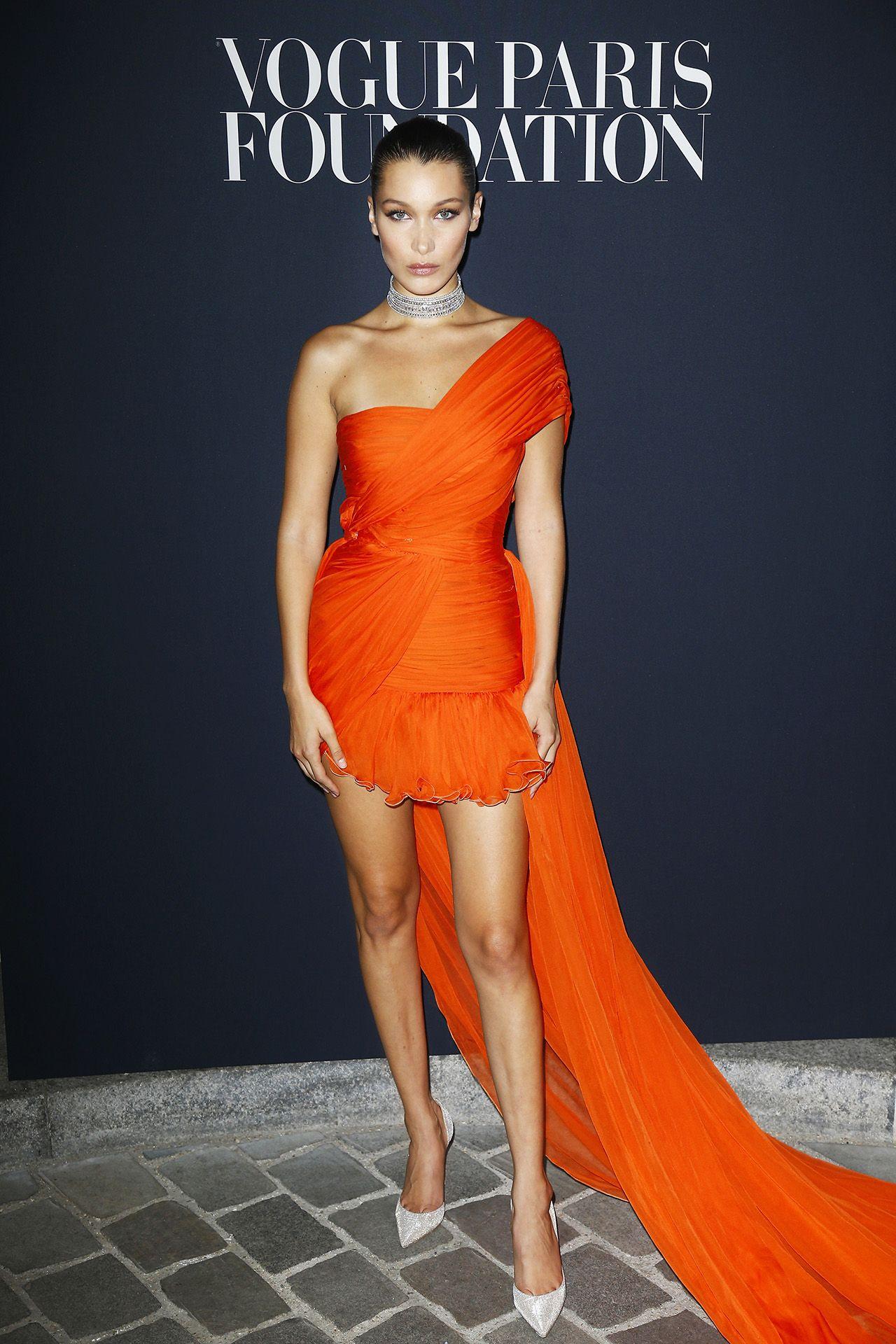 Bella Hadid in orange Giambattista Valli gown at Vogue Foundation Dinner  during Paris Fashion Week, 2017