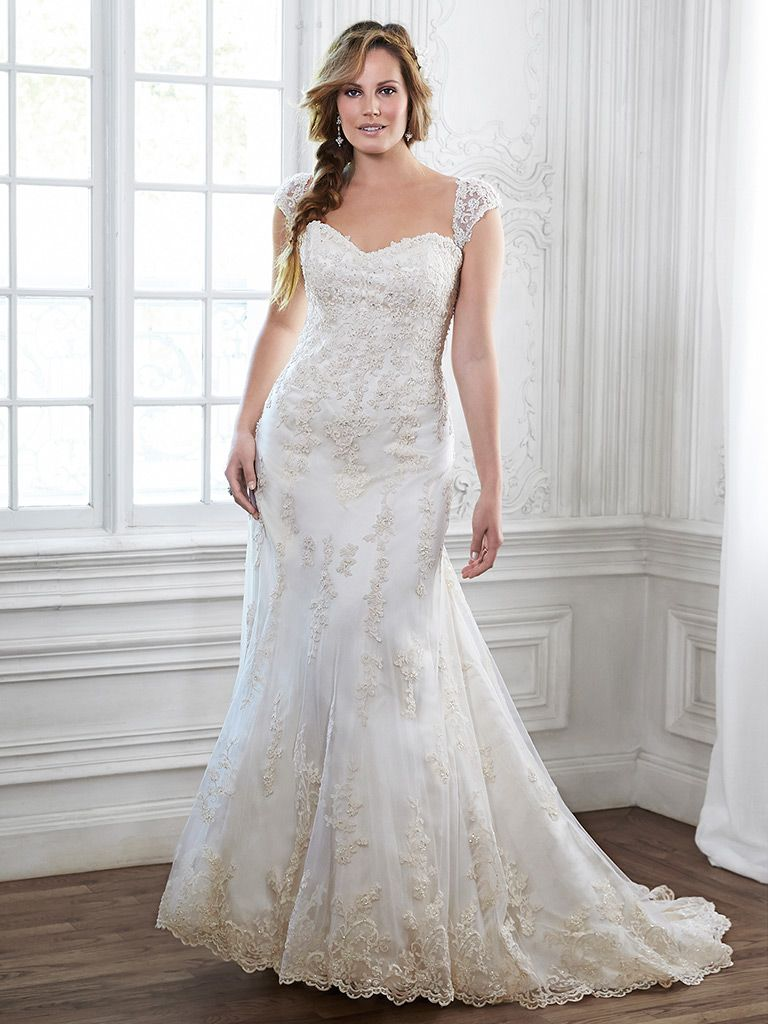 Stunning fitted lace wedding dress with cap sleeves by designer