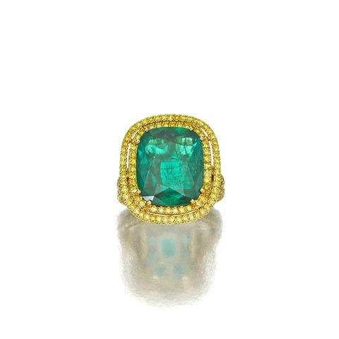 A 7.46 carats Colombianemerald and colored diamond ring.