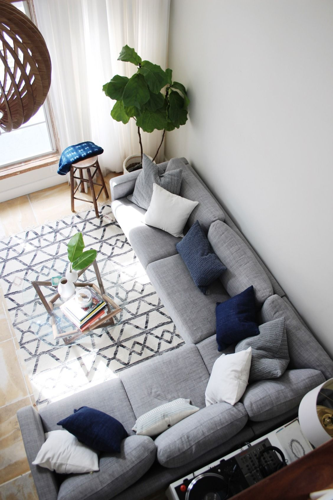 Step Into This Fabulous Art Deco Miami Apartment And Learn Laura Greig S Beach Y S Grey Couch Living Room Living Room Color Schemes Gray Sectional Living Room