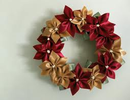 wreaths are just too easy not to make. Poinsetta bow instructions can be found online with a simple search. last year's xmas paper recycle project