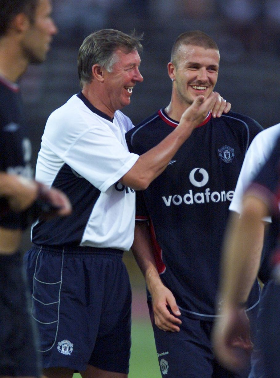 68d33962184 Alex Ferguson shares a joke with David Beckham during a training session in  Kuala Lumpar in July 2001
