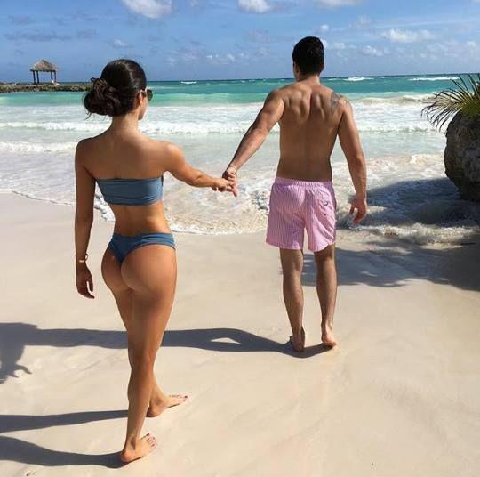 Boy In Shorts Taking Girlfriend To Beach Round Butt Body