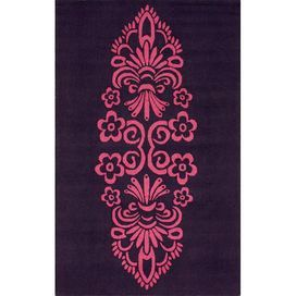 Hand-hooked wool rug with a damask-inspired design.