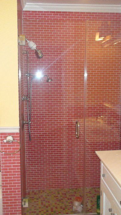 A Shower Done In Beautiful Pink Subway Tiles With Fun Mosaic Floor