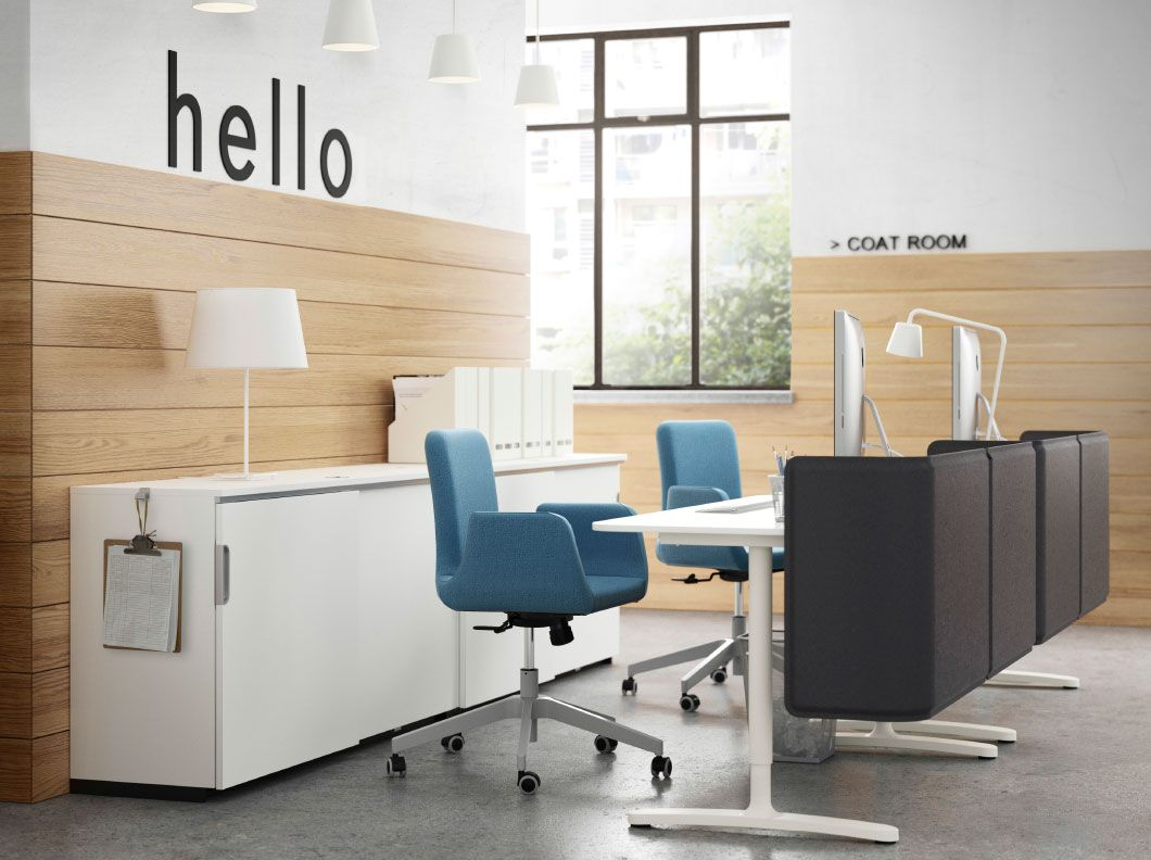 a reception with white desks storage cabinets and swivel chairs with blue cover ikea