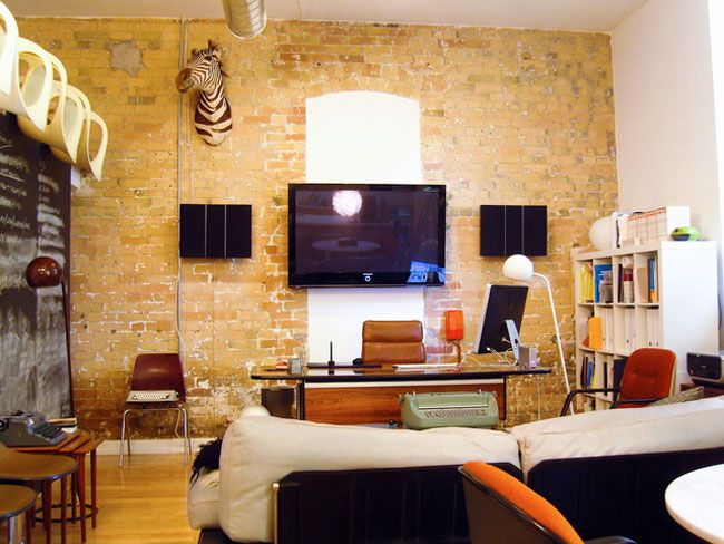 office and living room with mounted zebra head. yes. Exposed BrickBrick ...