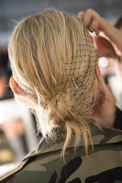 3.1 Phillip LimPaul Hanlon styled the hair in messy knots, accessorised with mesh and fabric headbands.