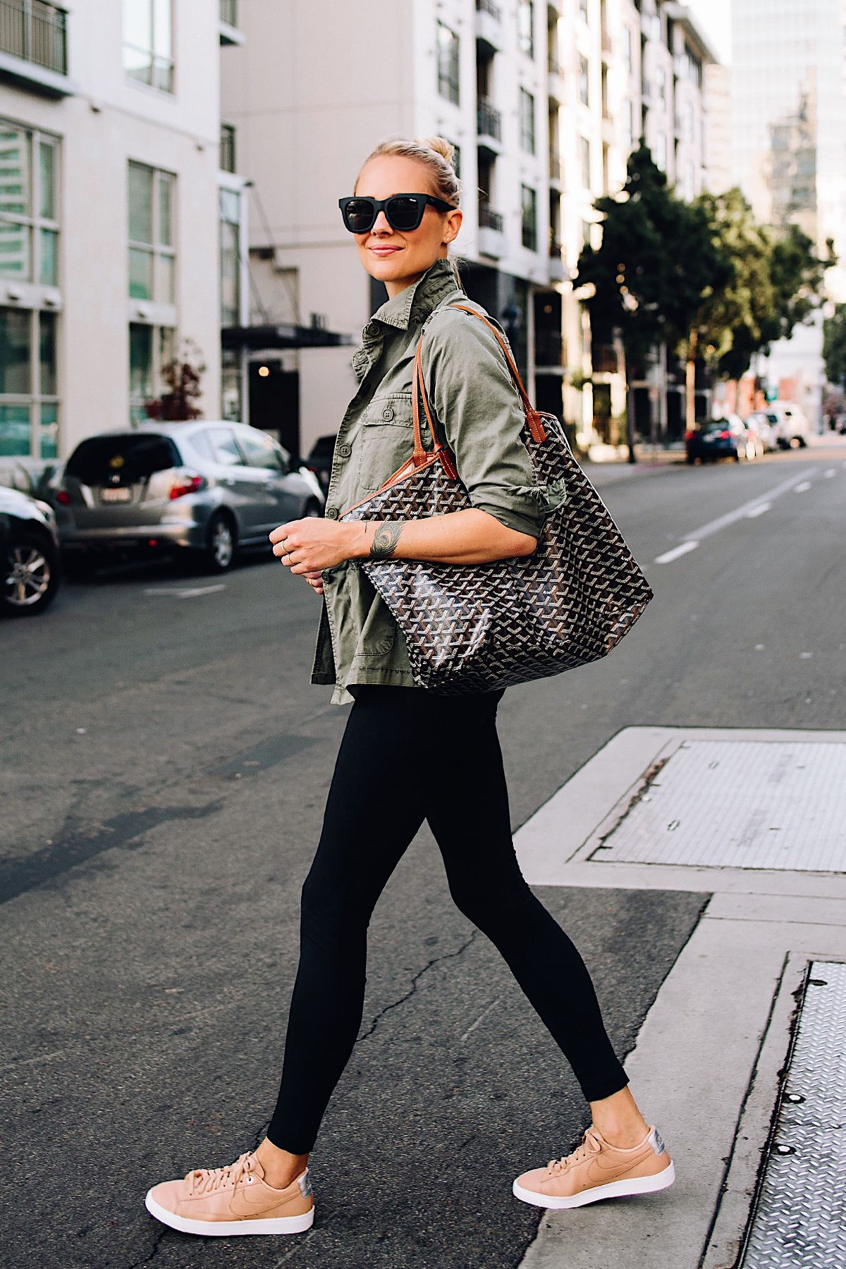6a8419cbca9 Blonde Woman Wearing Nordstrom Green Utility Jacket Black Leggings Nike  Sneakers Beige Goyard Large Tote Fashion Jackson San Diego Fashion Blogger  Street ...