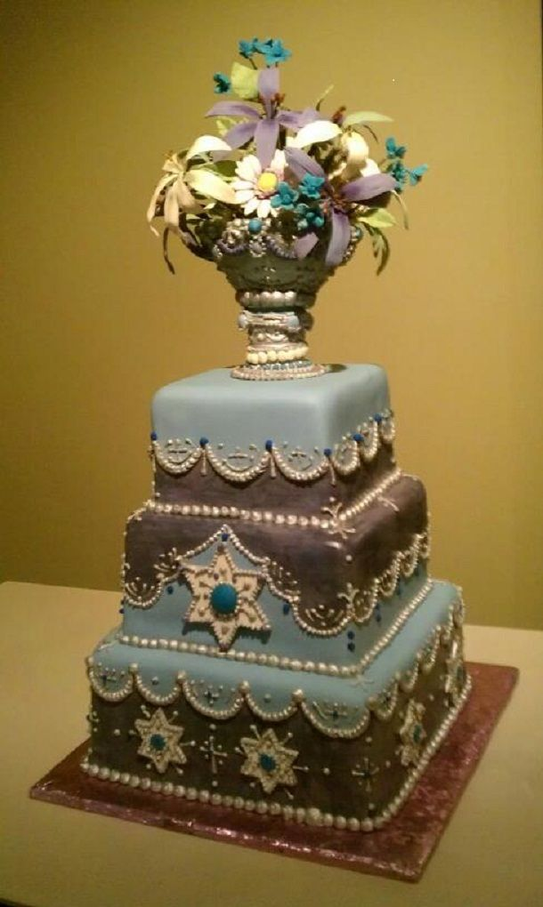 The couple wanted a cake with understated stars of david and crosses ...