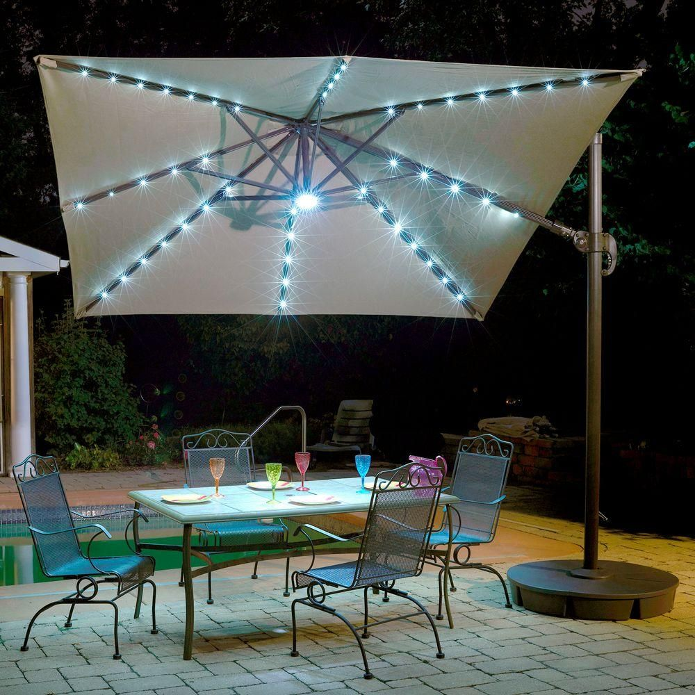 Island Umbrella Santorini Ii Fiesta 10 Ft Square Cantilever Patio Umbrella In Beige Sunbrella Acrylic Nu6245 The Home Depot In 2020 Patio Umbrella Lights Patio Umbrella Patio Lighting