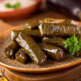 11 International Dishes That Will Give You Fomo Food Recipes Stuffed Grape Leaves