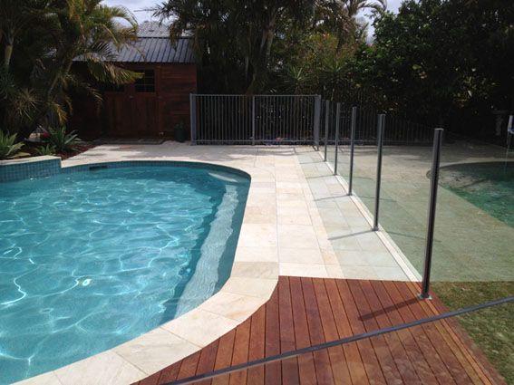 Natural sandstone timber deck glass aluminium pool