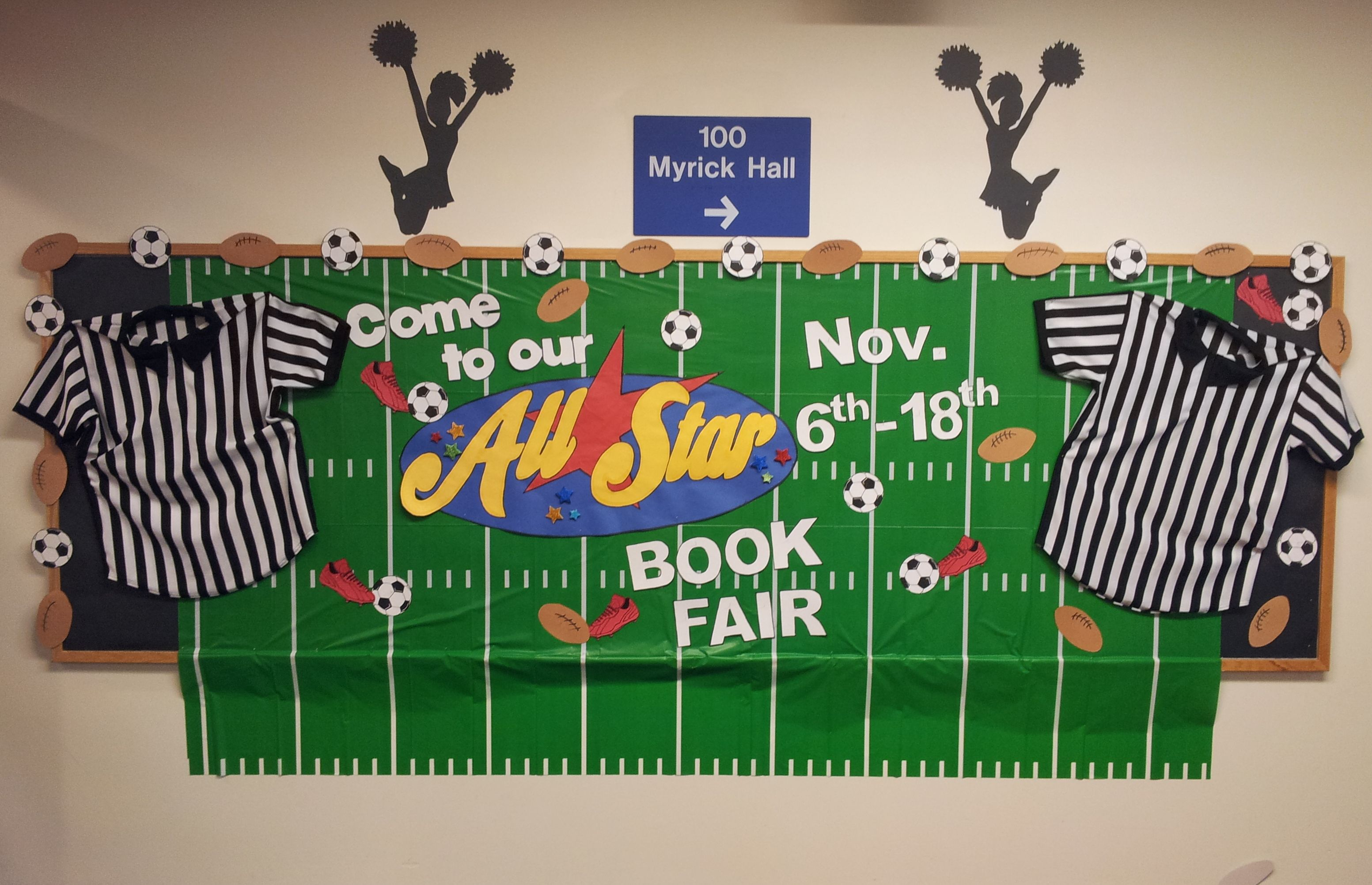 All Star Book Fair Bulletin Board library window, behind