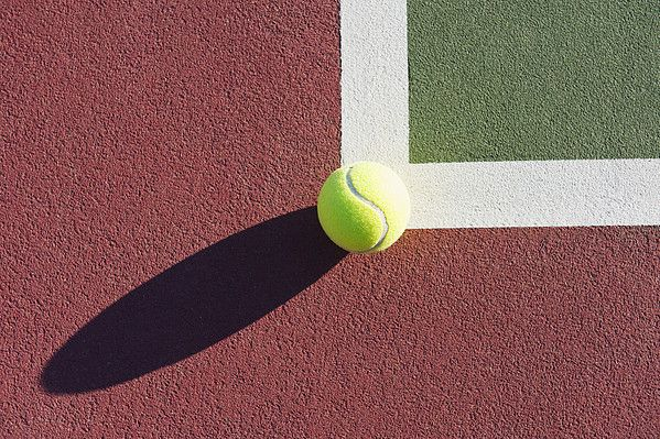 Tennis Ball Sitting On Edge Of Tennis Court By Thom Gourley