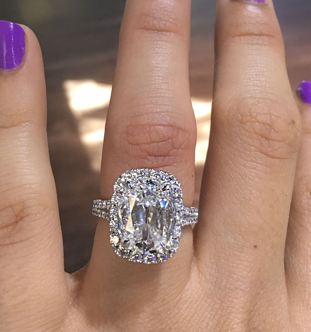A 426ct Cushion Cut Is Surrounded By A Beautiful 114ctw Halo And Diamond  Band