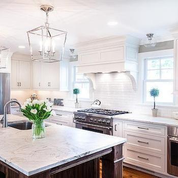 walnut kitchen island with honed granite countertops