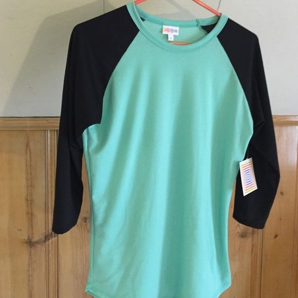 Lularoe Randy-S Absolutely stunning mint green and black baseball 3/4 sleeve popular Randy shirt by Lularoe. Soft as butter material and has a bit of a stretch to it. I would keep it, but I need a Med. This is perfect for a true size Small in shirts. 0-6.   Willing to trade for another Randy in Med or their black leggings. LuLaRoe Tops Tees - Long Sleeve