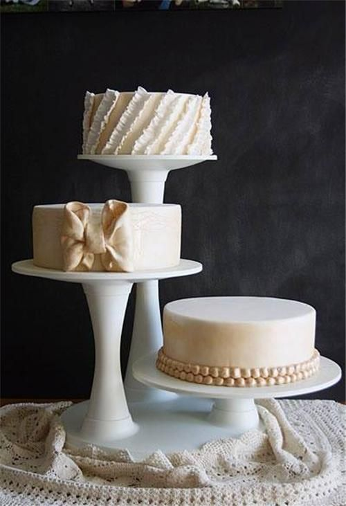 Three Round Wedding Cakes On Different Leveled Stands Found On