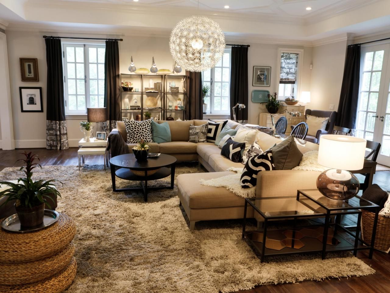 Eclectic Living Space With Bold Throw Pillows And Pendant Light