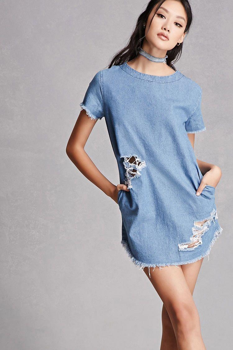 ac7467c7d5 A denim shift dress featuring a frayed trim