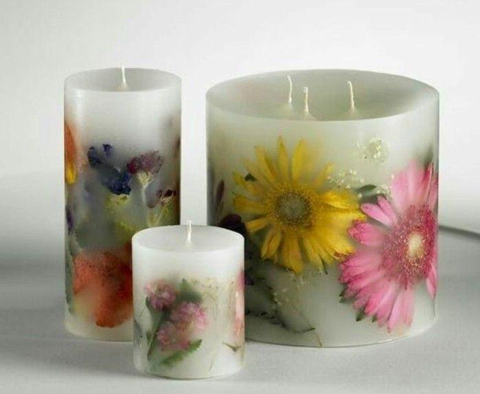trs joli exemple de bougies dcores de fleurs suggestion extrmement esthtique pour dcorer sa maison