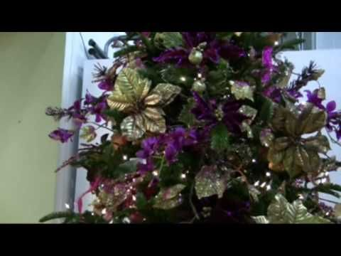 gold copper purple christmas tree using the obvious goldpurple poinsettias ribbons as well as purple orchids grapes and glitter sprayed - Purple And Gold Christmas Tree Decorations