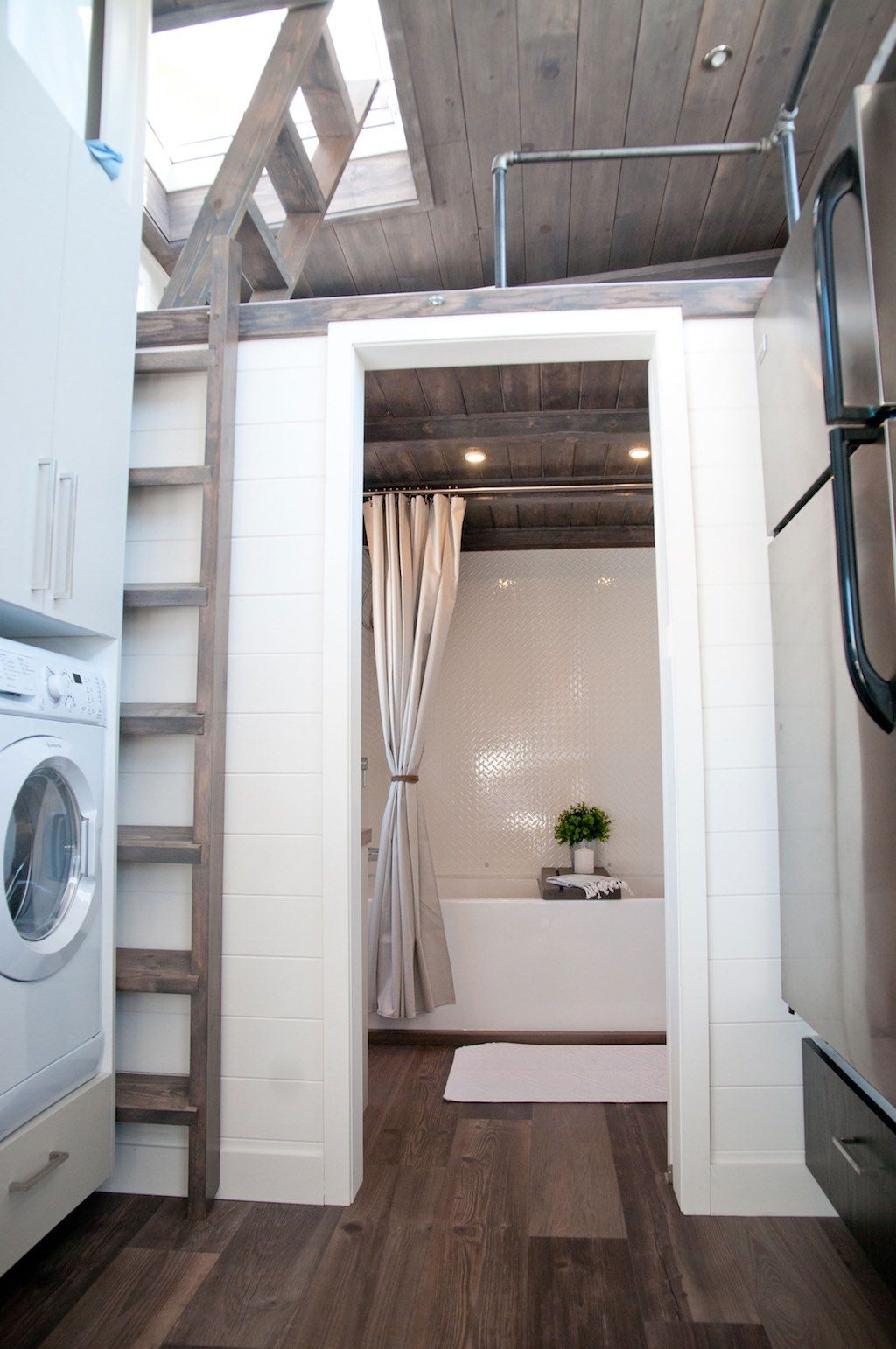 Tiny house with private bedroom offers minimalist chic for Minimalist house on wheels