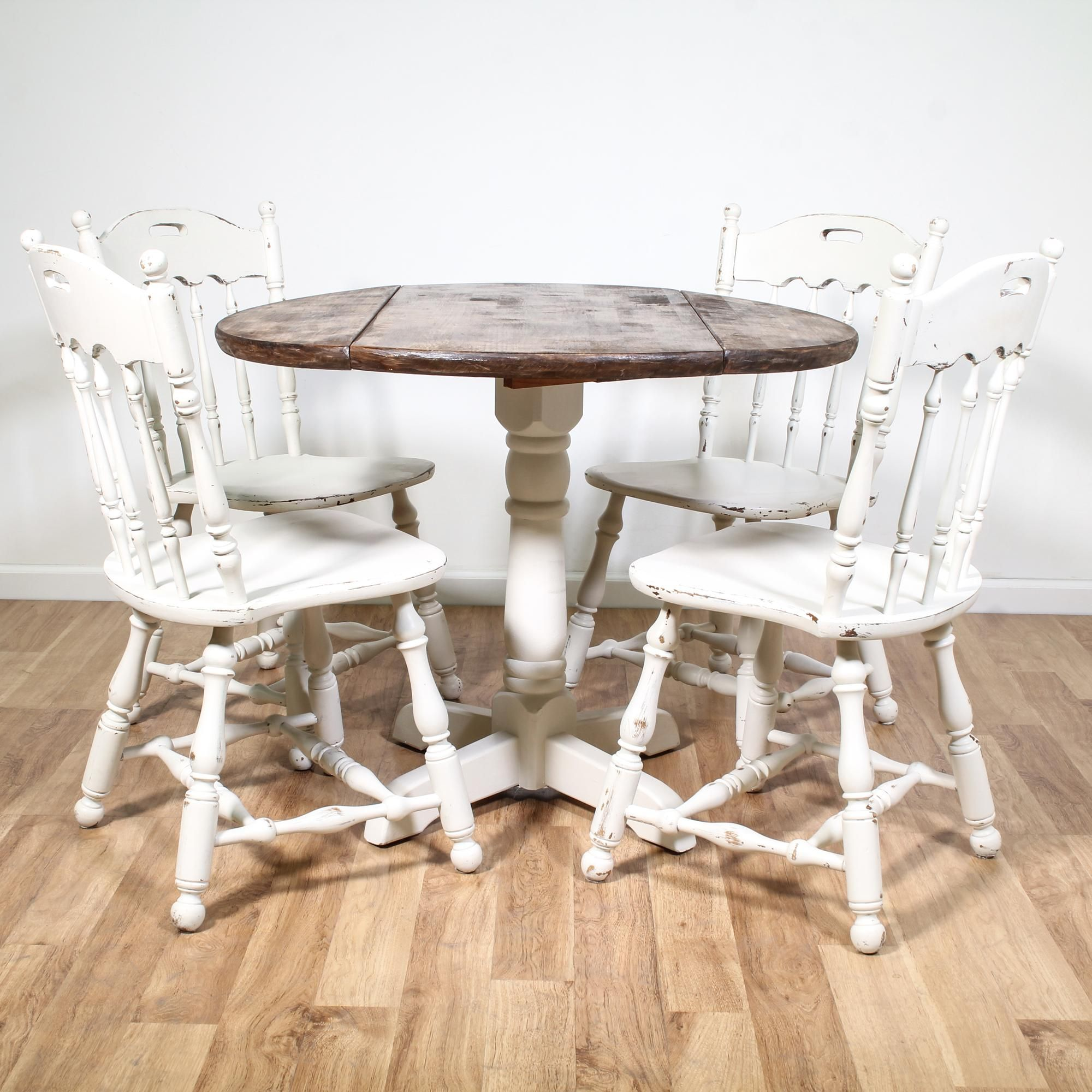 This cottage chic dining set is featured in a solid wood with a ...