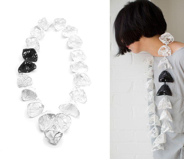 Myung Urso Neckpiece: Winter Breath, 2013 Katoen, gesso, zilver 15 x 61 x 7 cm On model