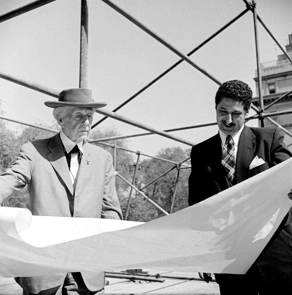 frank lloyd wright and david henken reviewing drawings for the pavilion photo