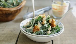 This sriracha kale caesar salad turns takes the traditional salad and turns up the heat and health with spicy sriracha and tuscan kale.