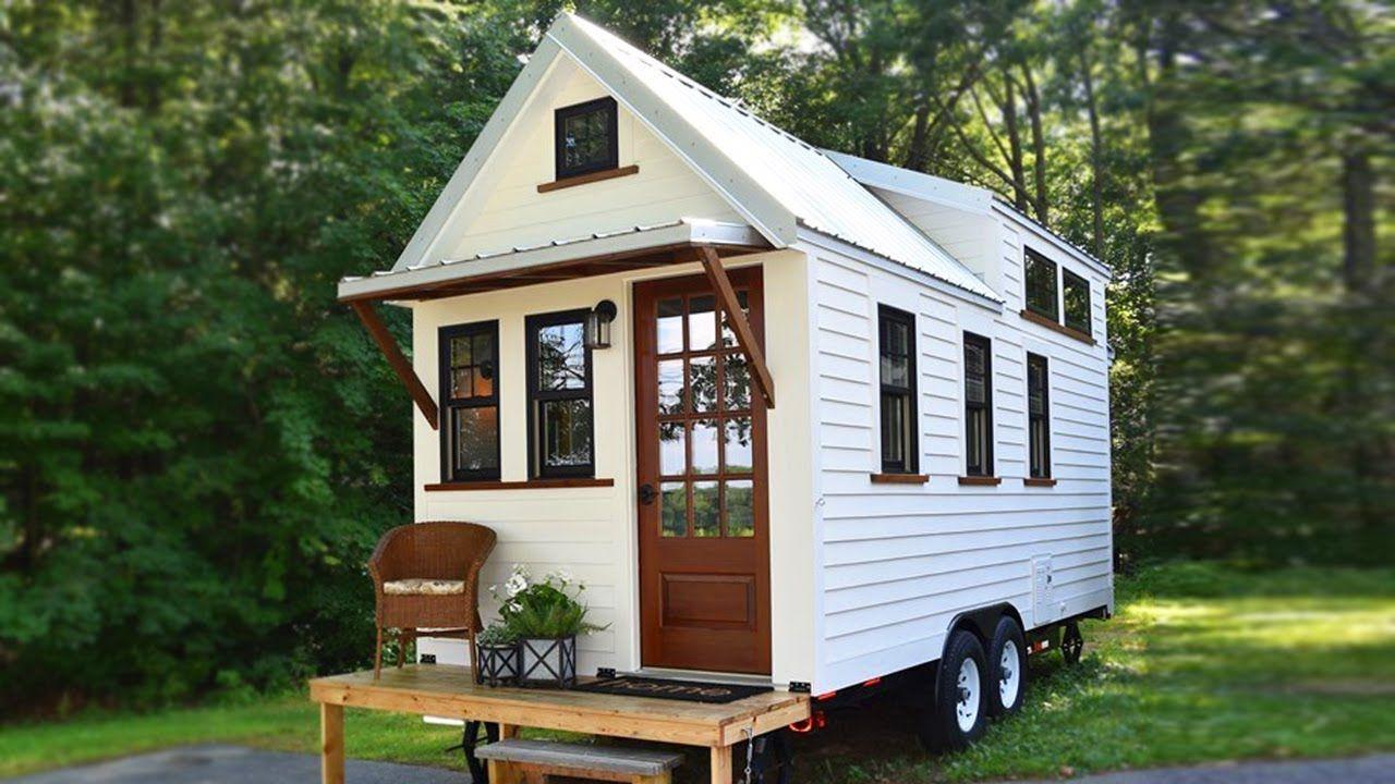 Stunning White Farmhouse Style Tiny House On Wheels Tiny Farmhouse Tiny House Exterior Tiny House On Wheels
