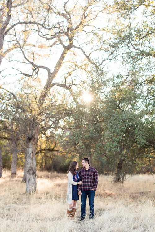 Engagement Portrait Standing In Field Holding Hands Looking at Each Other   Chico-California-Engagement-Wedding-Photographer-Bidwell-Park-Engagement-Photography