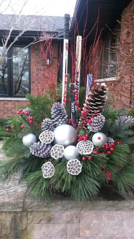 Hockey Sticks In Urn Memory Of A Coach Who Died Christmas Planters Christmas Urns Christmas Porch Decor