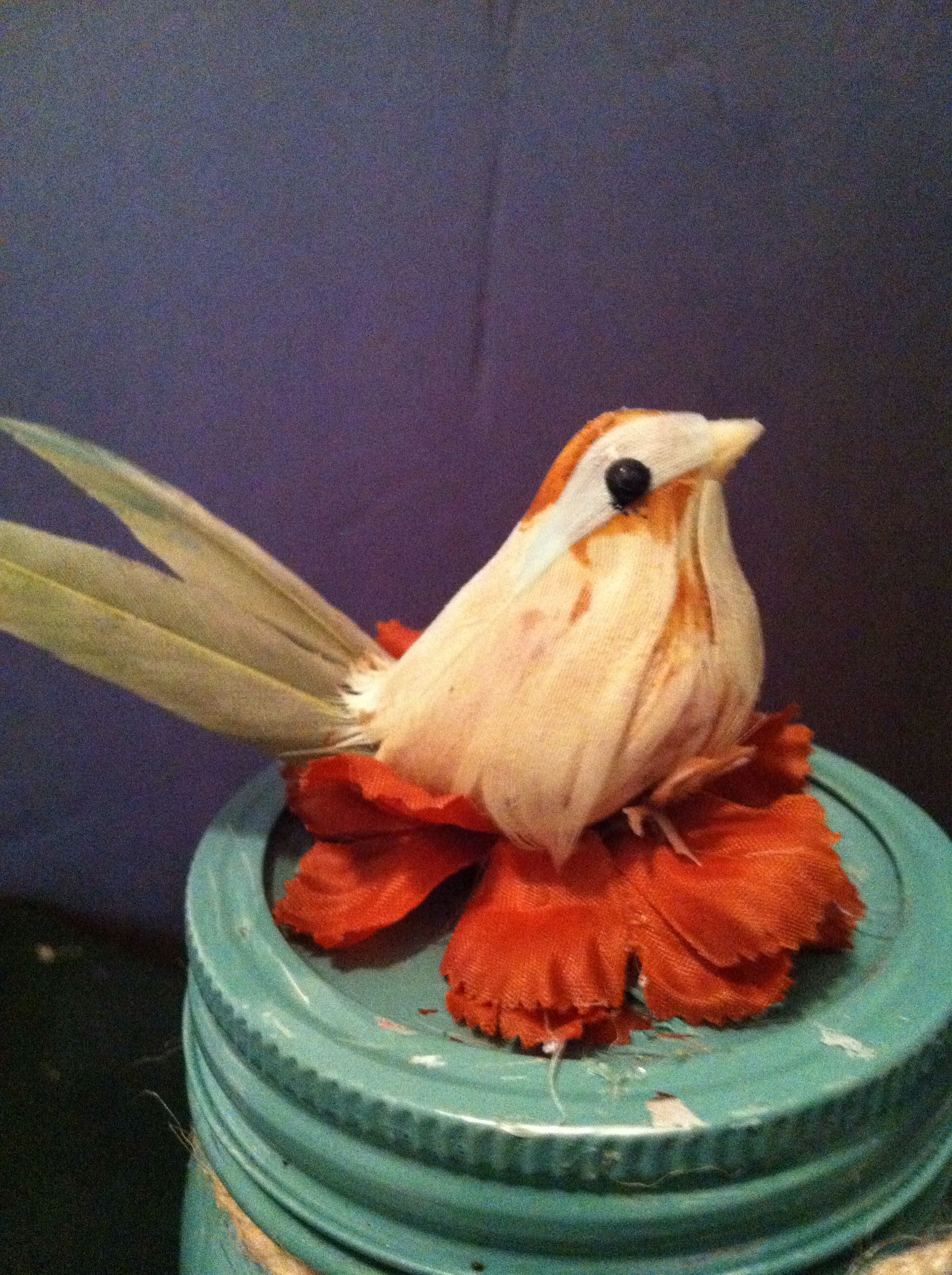 Green mason with bird accent