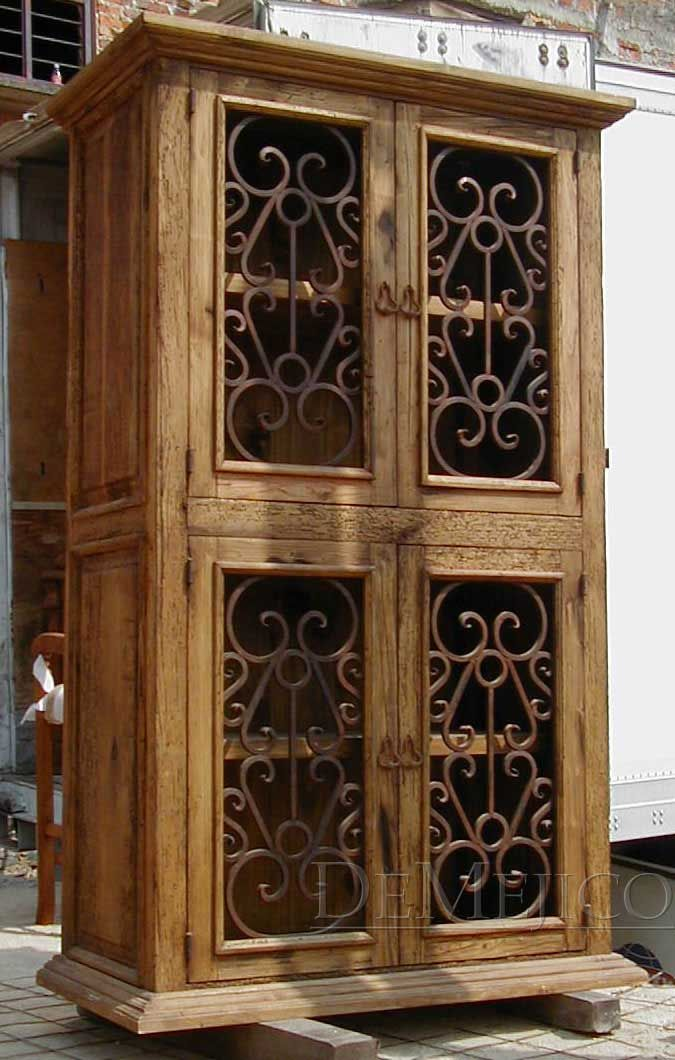 The Espanola Armoire features naturally distressed wormwood and hand-forged  weathered iron scrolling, creating